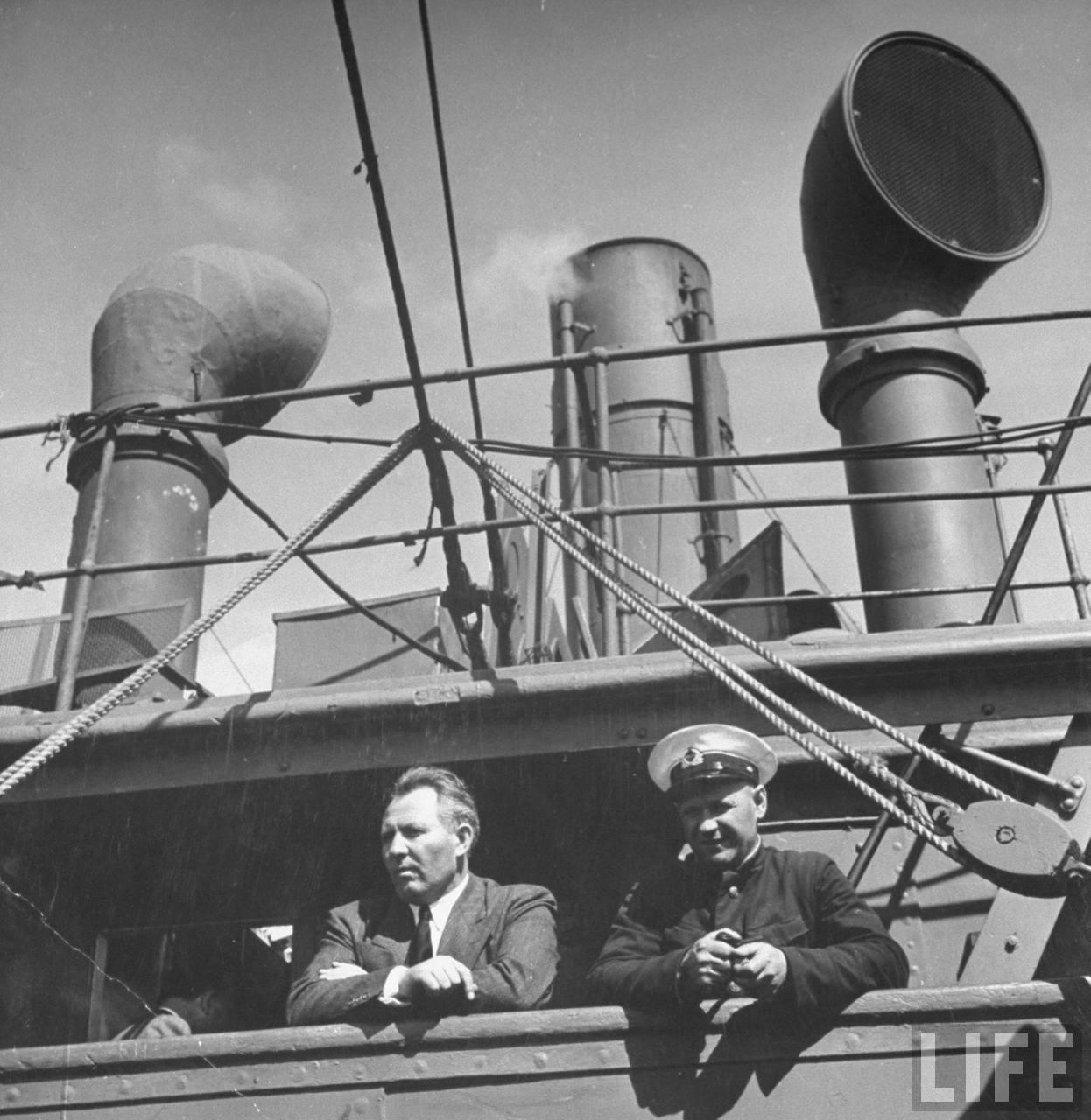 Captain standing on deck of Russian war ship.jpg
